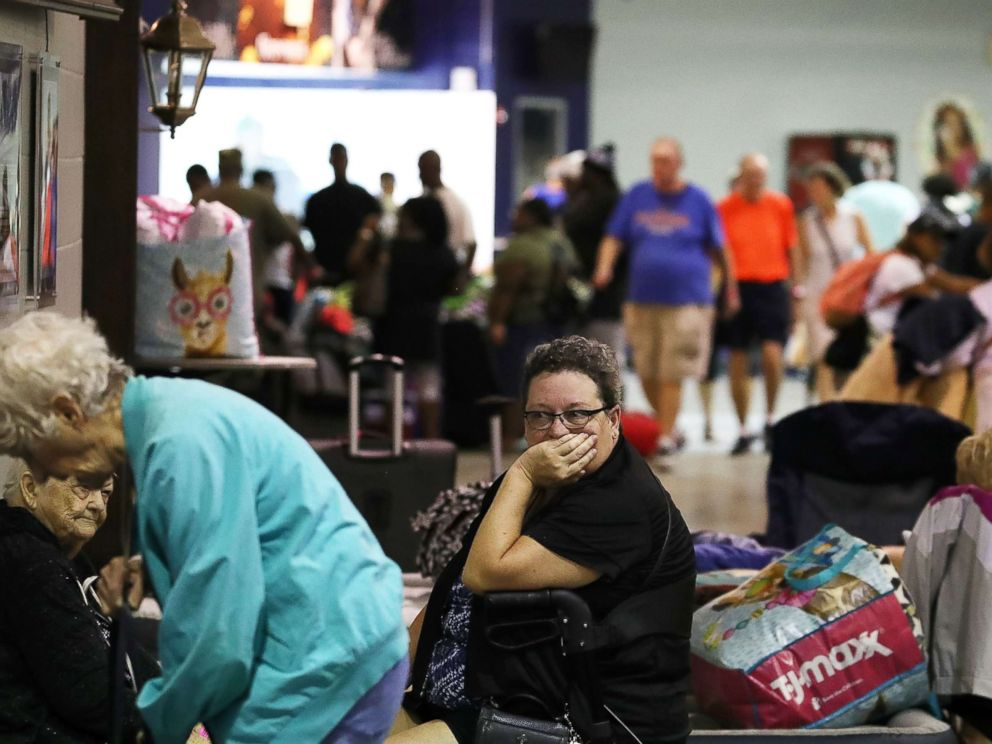 PHOTO: Evacuees sit inside of the Germain Arena that is serving as a shelter from the approaching Hurricane Irma, Sept. 9, 2017 in Estero, Florida.
