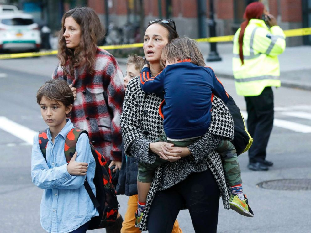 PHOTO: Parents pick up their children from P.S./I.S.-89 school after a shooting incident in New York City, Oct. 31, 2017.