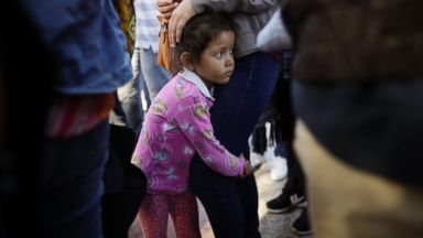 Government defends 'truncating' vetting process to reunite immigrant families
