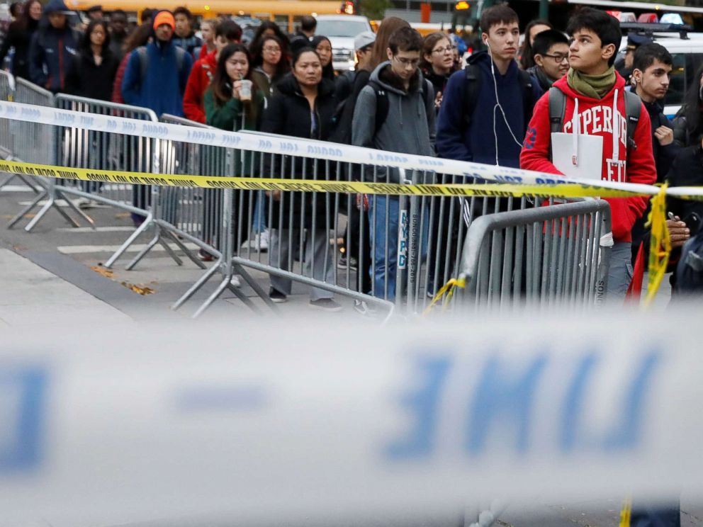 PHOTO: Students walk past police line tape on their way to school a day after a man driving a rented pickup truck mowed down pedestrians and cyclists on a bike path alongside the Hudson River in New York City, Nov. 1, 2017.
