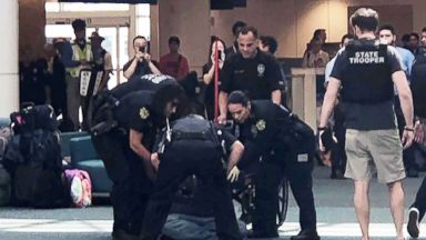 Panic unfolds at Orlando Airport after man attempts to breach security, travelers yell 'gun'
