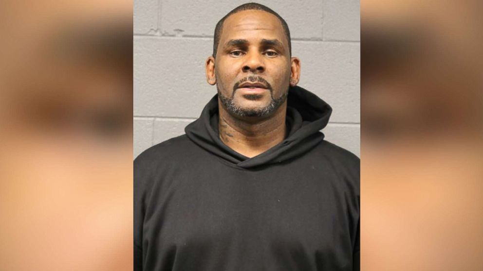 Image result for R. Kelly is arrested by feds on new charges while walking his dog in Chicago