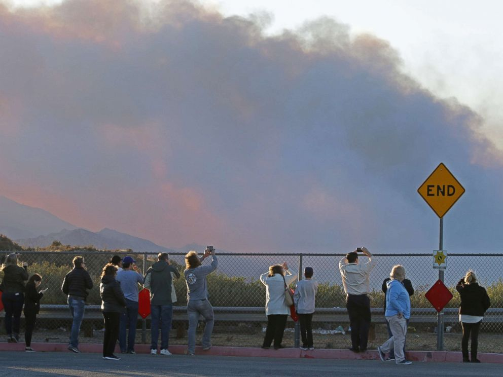 PHOTO: People gather on Poe Parkway in Stevenson Ranch to watch the fire fighting efforts on the Rye fire, Santa Clarita, Calif. Dec.5, 2017.