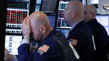 Dow tanks more than 700 points amid fears of China trade war