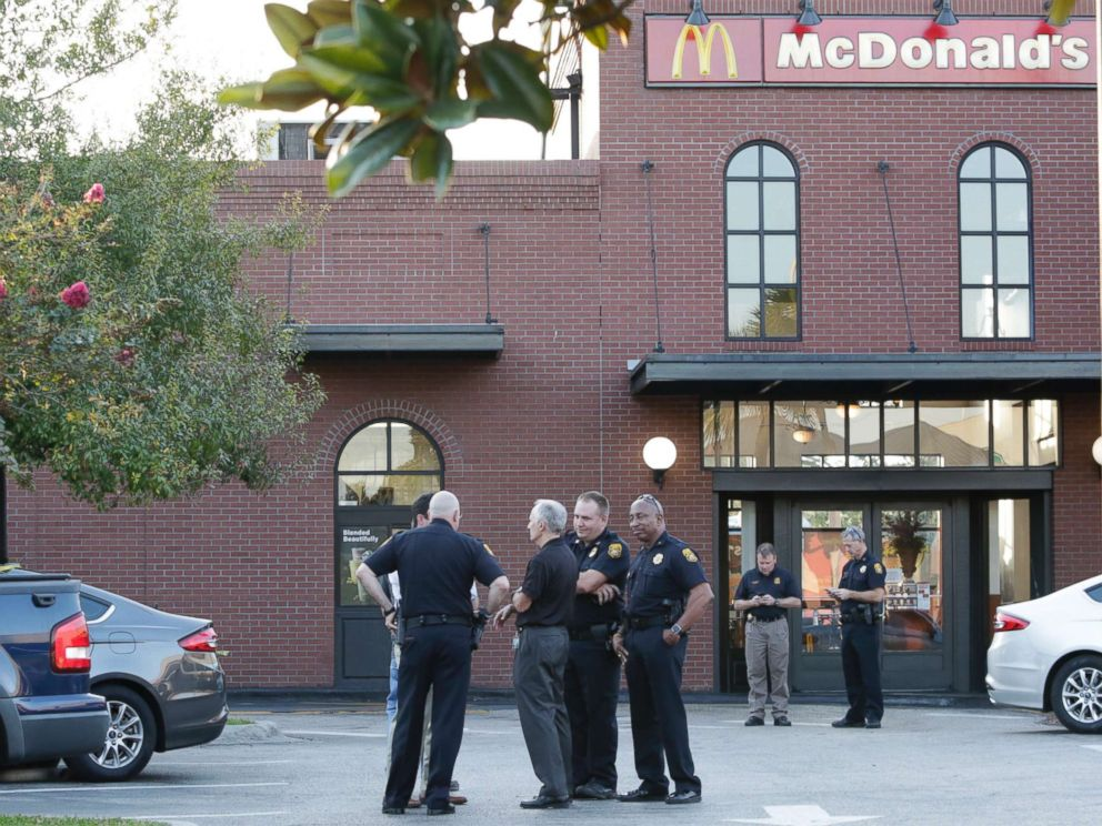 PHOTO: Police investigate on the scene following the trail of a man with a gun at a McDonalds in Ybor City, Tampa, Florida, on November 28, 2017.