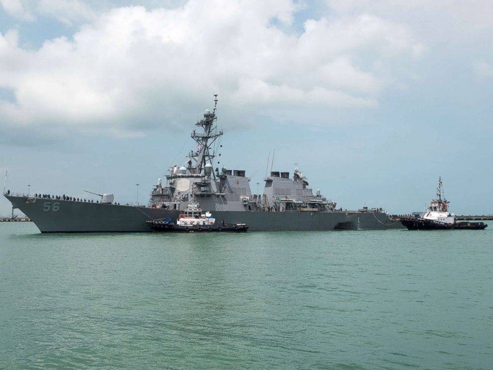 PHOTO: Tugboats from Singapore assist the USS John S. McCain as it steers towards Changi Naval Base in Singapore, after a collision with a merchant ship, Aug. 21, 2017.<p itemprop=