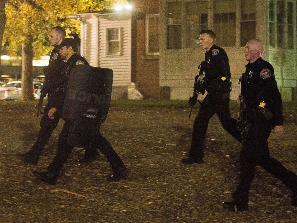 PHOTO: Police officers search for a gunman near the University of Utah campus in Salt Lake City, Oct. 30, 2017. Police say a deadly shooting occurred near the school campus on Monday.