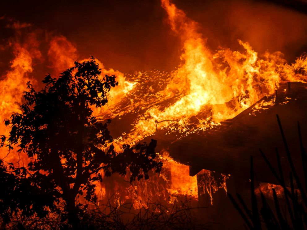 PHOTO: Flames engulf a home as brush fire sweeps through the area threatening structures on Dec. 5, 2017 in Sylmar, Calif.