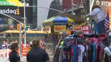 Bee swarm at NYC hotdog stand brings Times Square to a standstill