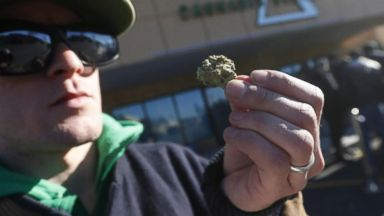 Thousands line up early in Canada to buy marijuana legally