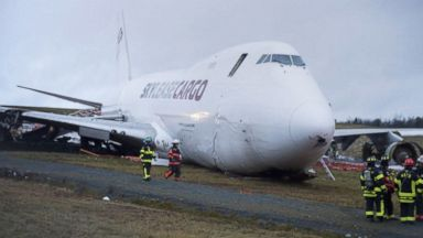 Cargo jet is badly damaged after overshooting runway, skidding onto grass