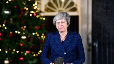 British PM Theresa May survives challenge to her leadership